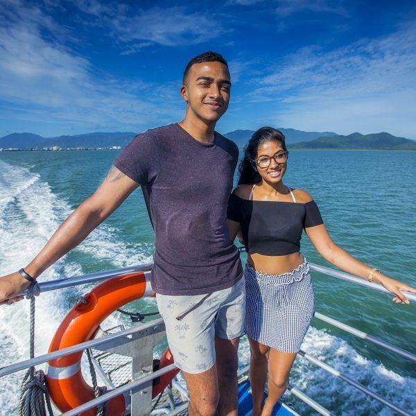 couple enjoying sun on top deck